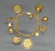 Armband, sog. Bettelarmband, GG 585, 11 verschiedene Anhänger: 2 Münzen, Bremer-Stadtmusikanten,
