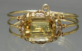 Armreif, WG/GG 585, 1 Citrin im Antikschliff, 2.5 x 2 cm, 6 Besatzdiamanten, 31 g
