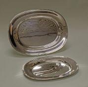 2 Vorlegeplatten, versilbert, Wilkens, oval, Profilrand, 35.5 x 26 cm bzw. 44.5 x 33 cm