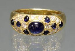 Ring, GG 750, 9 Saphire zus. ca. 0.40 ct., 14 Brillanten zus. ca. 0.28 ct., etwa tw/vvs, 11.5 g, RM