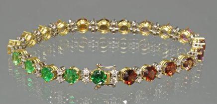 Armband, GG 750, 42 Brillanten zus. ca. 2.10 ct., 21 verschiedenfarbene Edelsteine u.a. Citrin, ver