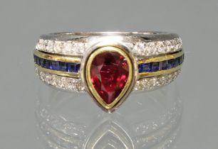 Ring, WG/GG 750, 1 Rubin im Tropfenschliff, 16 Saphircarrées, 28 Diamanten zus. ca. 0.56 ct., 8 g,