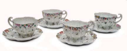 A Set of four Cups and Saucers