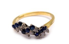 Ladies ring with diamonds and sapphires