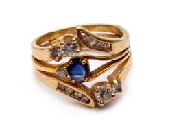 A blue sapphire and diamond ring