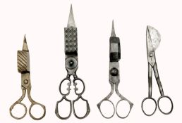 A Collection of Four Wick Trimmers