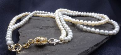 double rigged pearl necklace