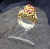 RING WITH RUBIES - 750 yellow gold