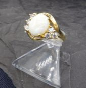 RING WITH PEARL MUTTING - 333 yellow gold