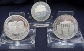 THREE COINS: Landing on the moon, coin