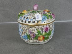 LIDDED BOX WITH PLASTIC FLOWERS