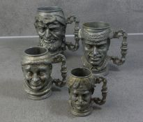 FOUR FIGURAL METAL JUGS WITH CHARACTER HEAD