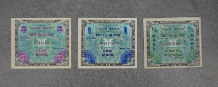 THREE BANKNOTES OF THE ALLIED MILITARY AUTHORITY