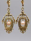 Paar Ohrgehänge mit Orientperlen (GIA-Vor-Expertise), um 1900. 585/- Gelbgold. Gesamtgewicht c