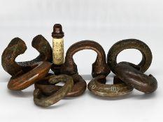 8 Manillen / Armreifen; Westafrika; wohl 18./19. Jahrhundert.<br><br>Verschiedene Metalle (u.a. Bron
