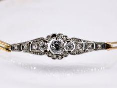 Armband mit kleinen Altschliff-Diamanten; zus. ca. 0;2 ct; Art Deco.<br><br>585/- Gelb- und Weißgold