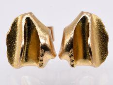 Paar Lapponia-Ohrstecker; 20. Jh.<br><br>585/- Gelbgold. Gesamtgewicht ca.3 g. Unregelmäßige Form un