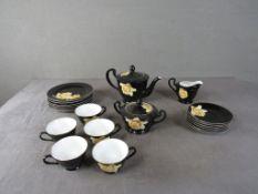 Teeservice Noritaka schwarz mit gelber Rose