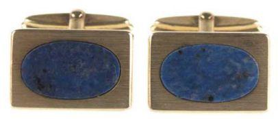 Paar Manschettenknöpfe, 14 kt GG, rechteckige Form besetzt mit ovaler Lapislazuliplatte,Ges.