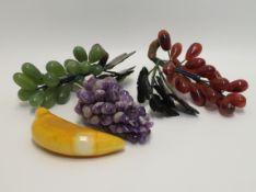 4 teiliges Konvolut diverser Tischdekorationen, Glas und Edelsteine.
