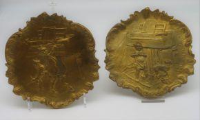 2 Teller, um 1900, Bronze mit reliefierter, humoristischer Kinderdarstellung, d 17,5 cm.
