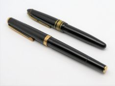 2 Füllfederhalter, 1 x gem. Geha, Feder 14 kt Gelbgold, gepunzt, l 11,5/14 cm.