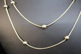 585/14kt.Halskette Vintage mit kleinen Kugeln Dm:0.5mm L:88cm Gewicht:18.6gr..
