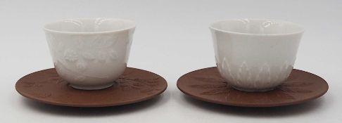 2 Koppchen mit Untertassen Porzellan MEISSEN,Sammleredition, versch. Dekore, jew. in O