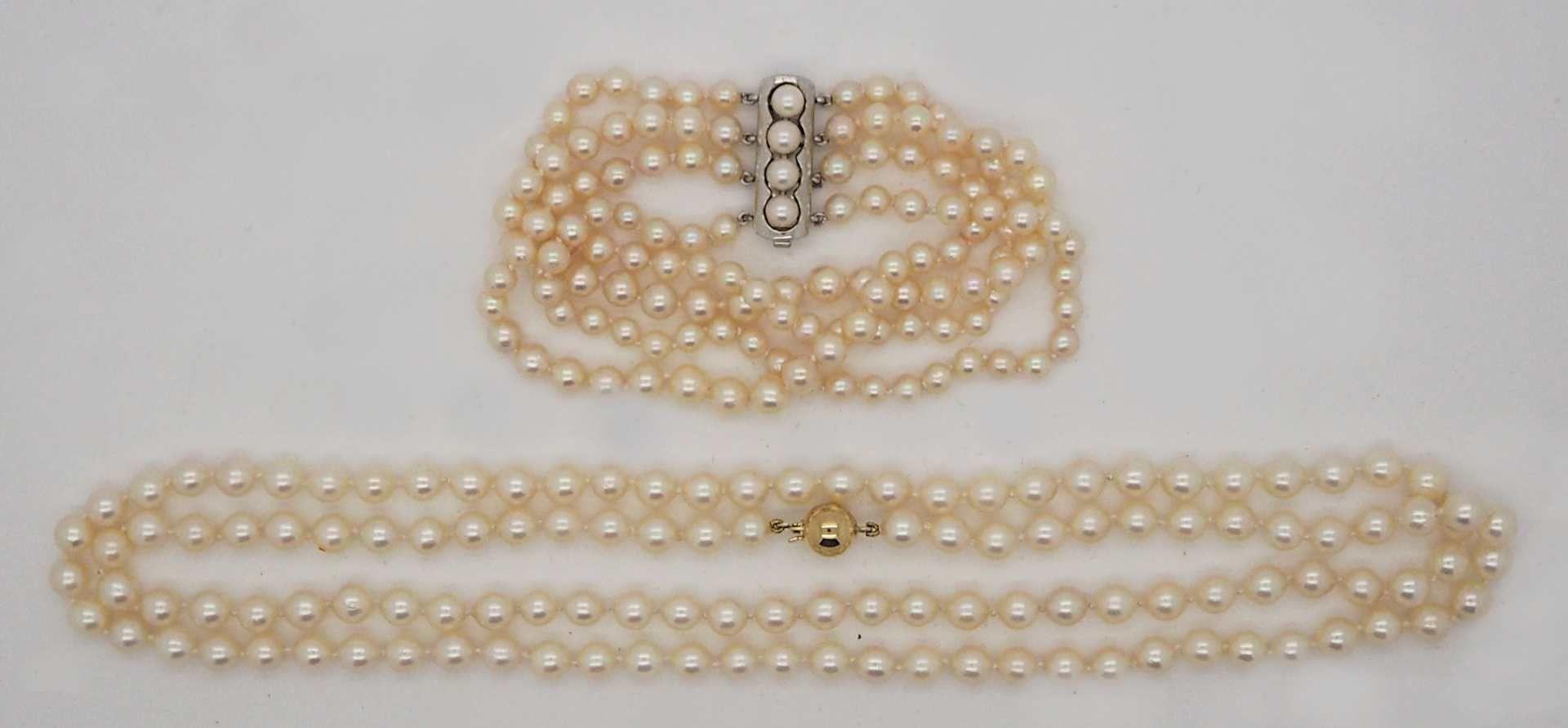 1 Perlenkette, Verschluss GG 14ct., 1 Perlenarmband, Verschluss Silber 925
