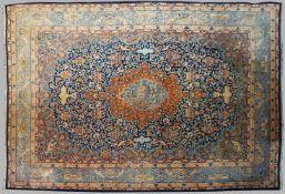 1 Orientteppich KASCHMIR, Iran, wohl 1930er-1960er Jahre Mittelfeld blaugrundig mit 4