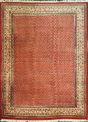 1 Orientteppich rotgrundig mit mehrfarbiger Randbordüre abstrakt-geometrischer Dekor,