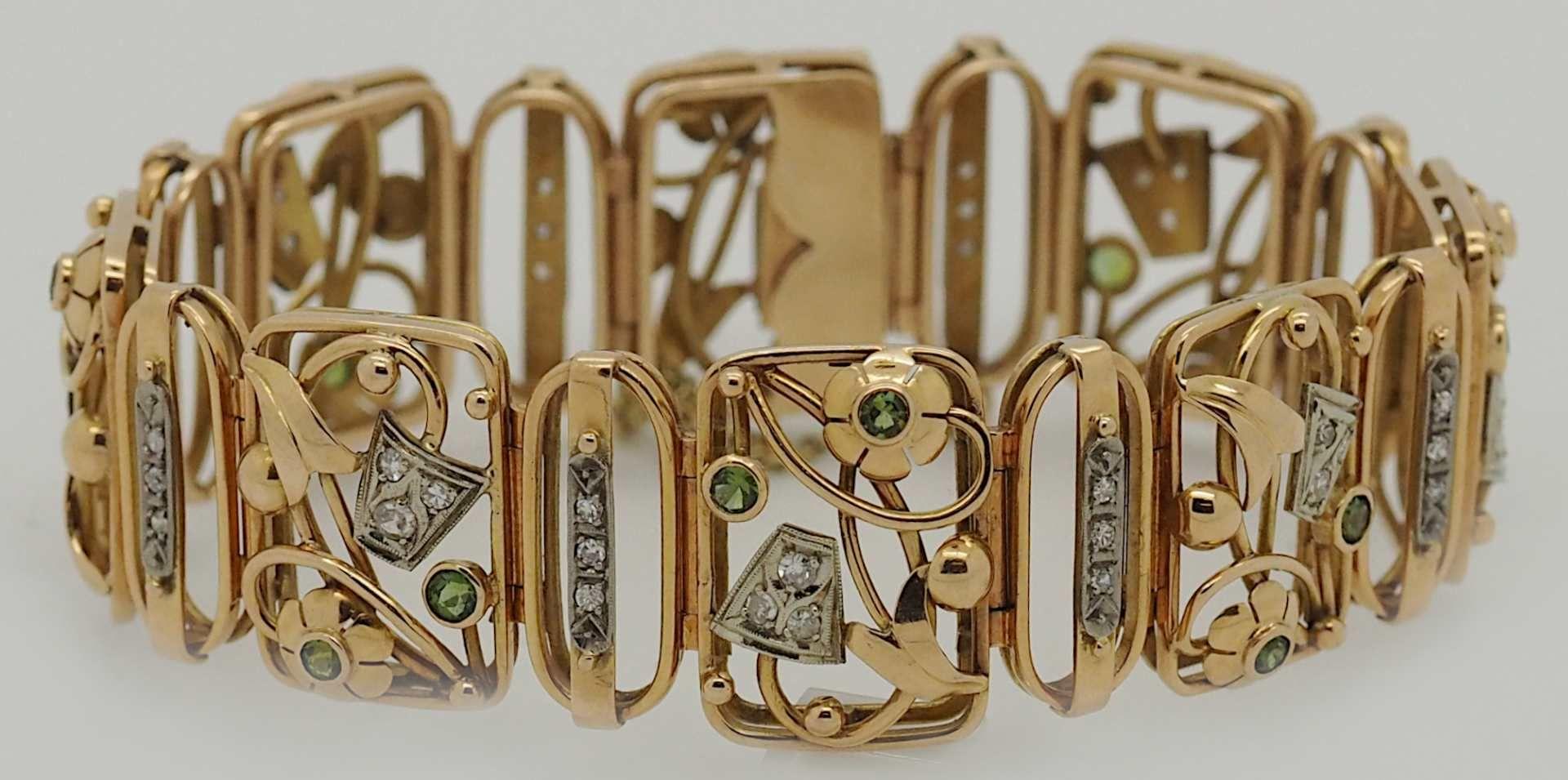 1 Damenarmband GG/WG 14ct. Brillanten, grüne Edelsteine (Peridot?)