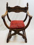 1 Scherenstuhl wohl Anfang 20. Jh., Holz beschnitzt mit Löwen- und Fratzendekor auf A