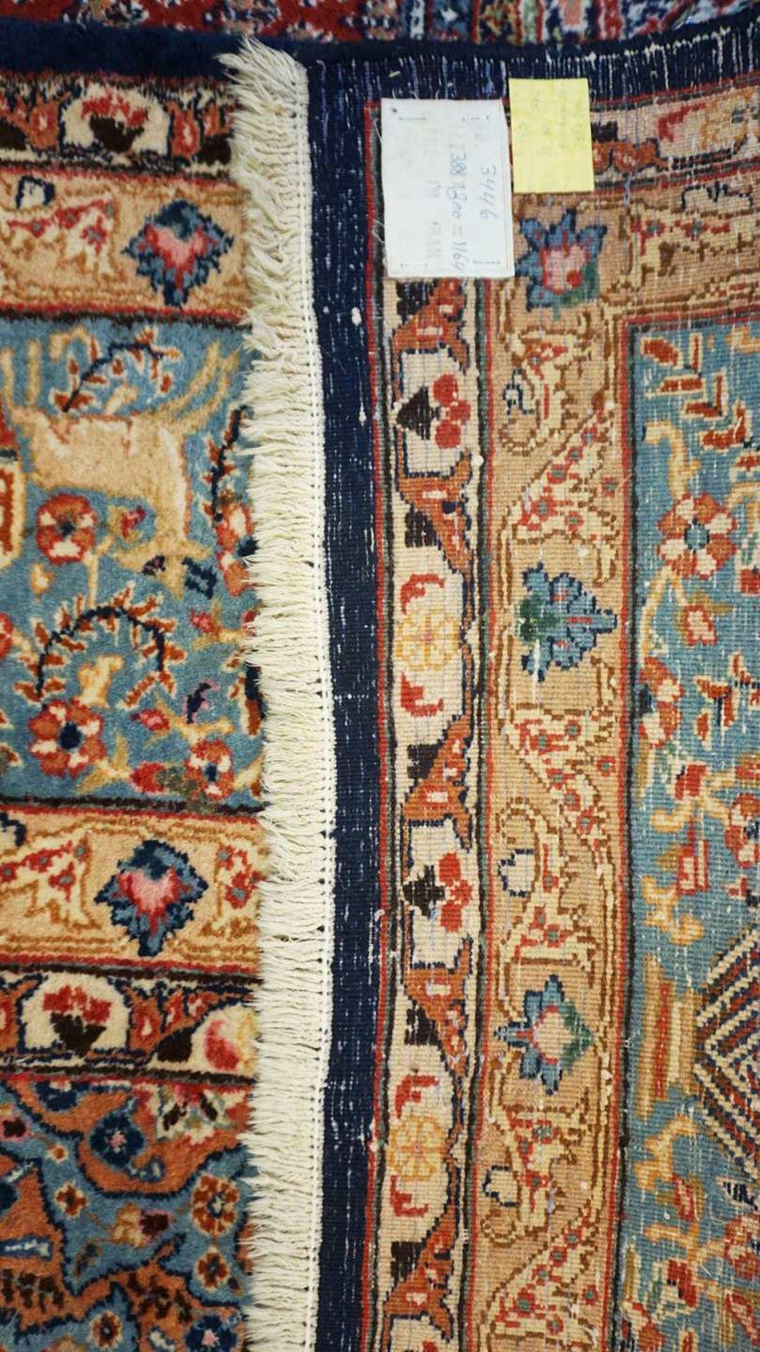 1 Orientteppich KASCHMIR, Iran, wohl 1930er-1960er Jahre Mittelfeld blaugrundig mit 4 - Bild 2 aus 2