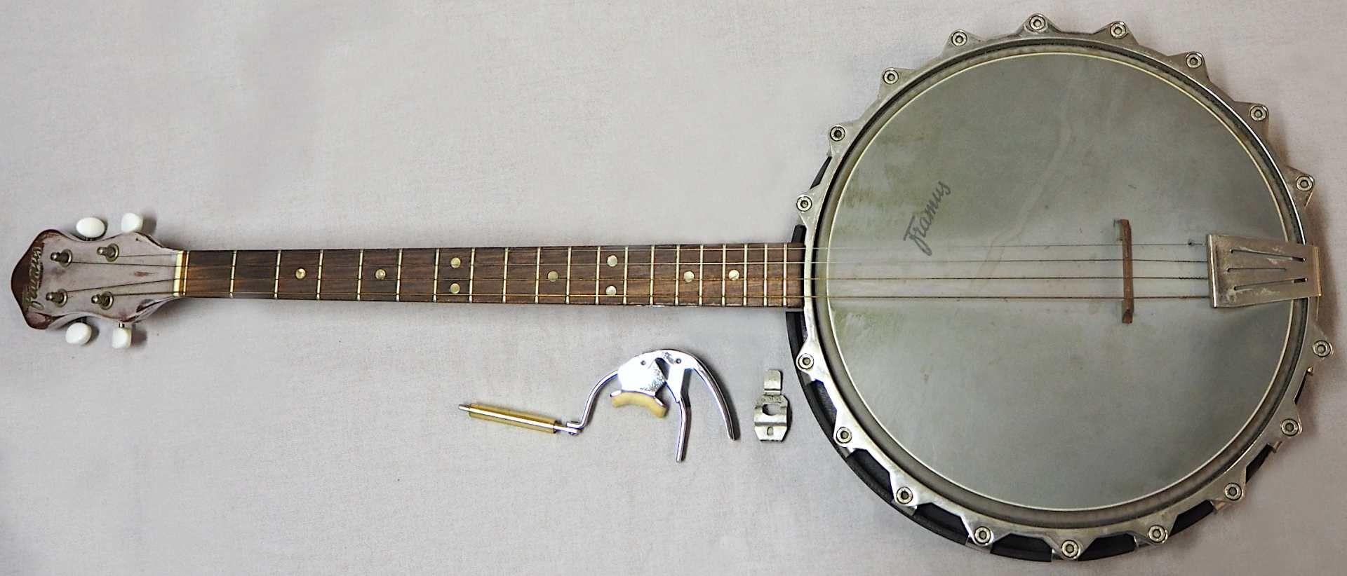 1 Banjo auf Resonanzfell/Kopfplatte bez. FRAMUS, wohl 1960er Jahre 4-saitig, mit Metal