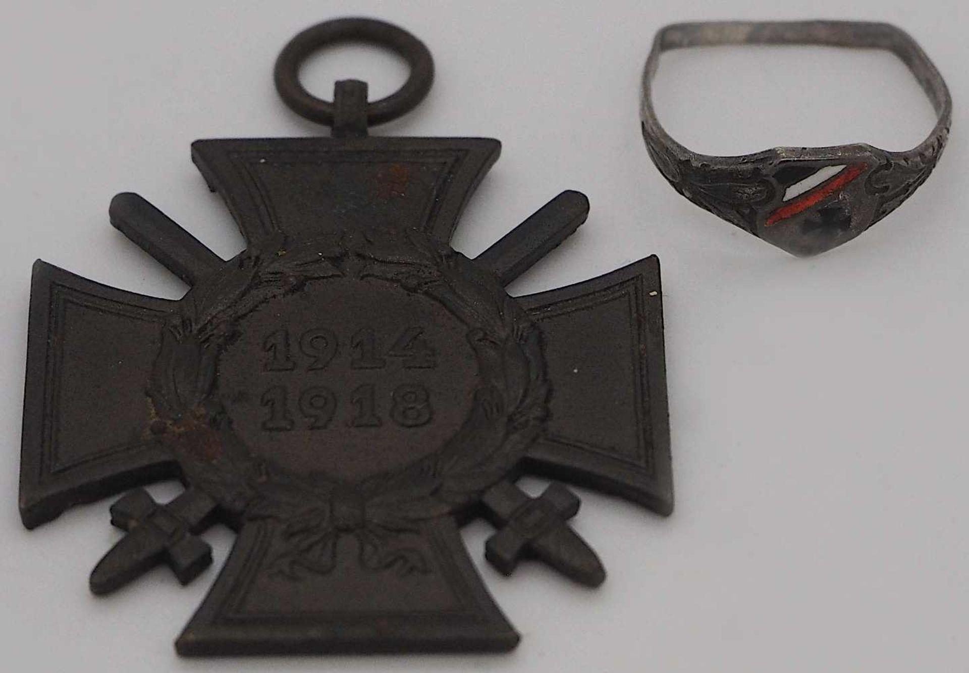 1 Orden/Abzeichen I. WK sowie 1 Ring besch. Gsp.