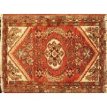 1 Orientteppich rotgrundig, Mittelfeld mit rautenförmigem geometrisch- floralem Dekor, 20. Jh.<