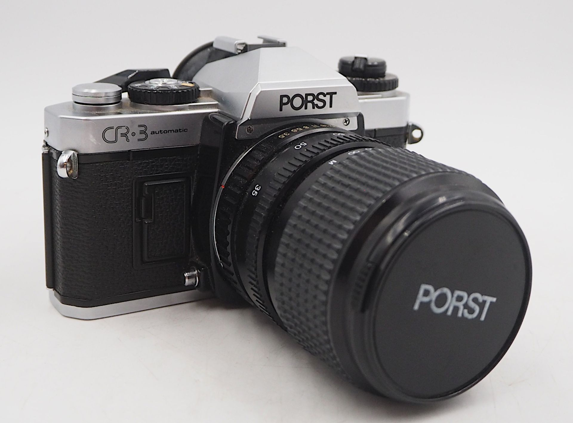 "1 Fotoapparat PORST ""CR-3 Automatic"" mit Objektiv PORST ""Unizoom 1:3,5-4,5/35-70mm Mac"