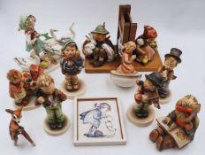 "1 Konv.Hummelfiguren Porzellan GOEBEL, 2. Hälfte 20. Jh.: versch. Modelle ""Knabe mit"
