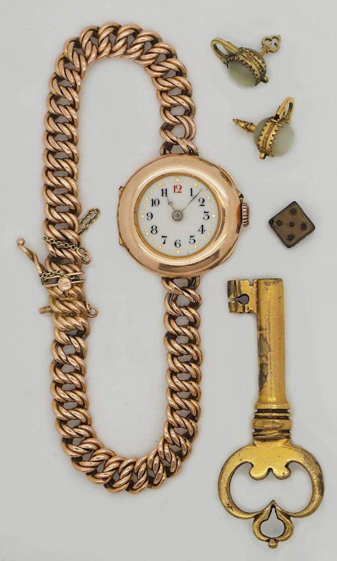 1 Damenarmbanduhr GG 14ct., Band GG 14ct. besch. (Glas fehlt), sowie 2 Miniaturschlösser Perle