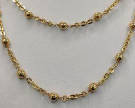 Lange Ankerkette mit Kugelelementen, 750/18K Gelbgold, 25,52g, Länge 82cmLong anchor chain with