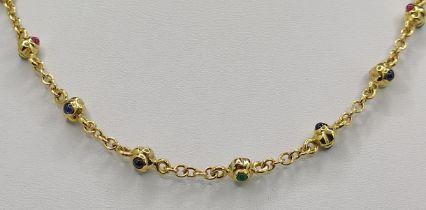 Kette mit Kugelelementen und Schmucksteinen, 750/18K Gelbgold, Italien, 24g, Länge 42cmNecklace with