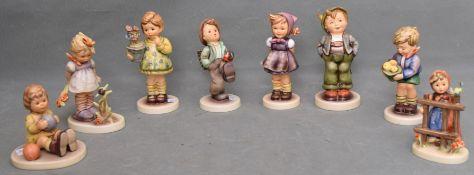 Konvolut acht Hummel-Figuren