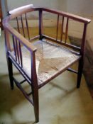 An Arts and Crafts beech hoop back chair, rush seat, tapered legs, 77cm high, 68.5cm, c.1890