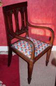 An Art Nouveau mahogany chair, pierced tulip splat back, drop-in seat, tapered legs, spade feet, c.