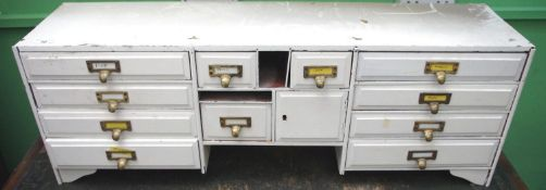 A 19th century white painted stationery cabinet, fitted with twelve drawers, 34.5cm high, 98cm wide,