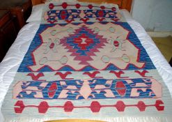 A 20th century kilim, geometrical pattern, in red, blue and white, 165cm x 115cm