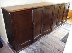 A Victorian mahogany and pine six door housekeepers cabinet, fielded doors, 301cm long, 109cm