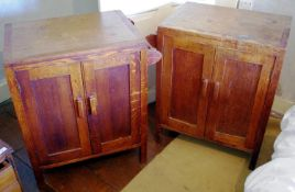 A pair of 20th century Heals limed oak bed side cabinets, two panelled doors, towel rail to one
