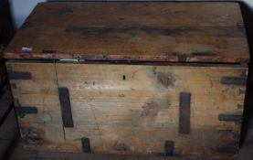 A late 19th century pine and metal bound travelling trunk, handles to sides, 49cm high, 92cm wide,